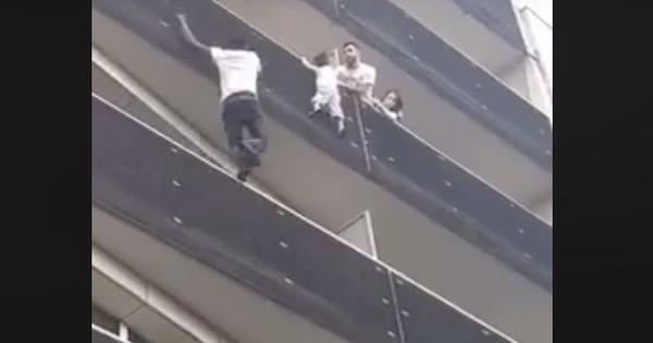 Watch: A man scaled four storeys of a building from the street to save a little boy. He's a hero now