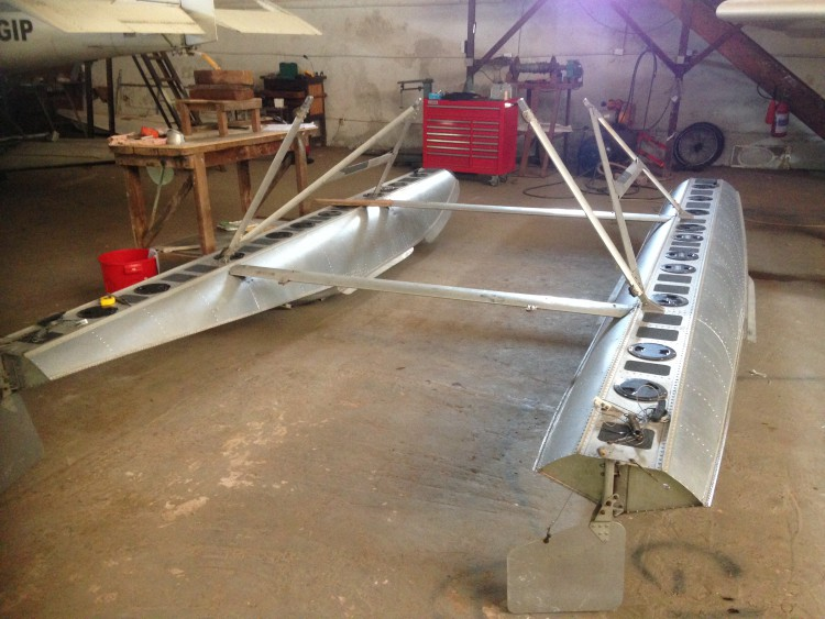 Aluminum floats set up to go under the plane