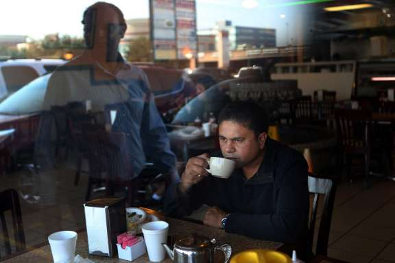 Million for La Voz  Jawed Akhter, of India, drinks hot tea at Persian restaurant, The Darband Shishkabob, on Thursday, Feb. 12, 2015, in Houston.