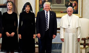 Pope Francis poses with Donald, Melania and Ivanka Trump at the end of a private audience at the Vatican.