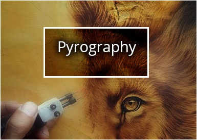 Pyrography of a lion on wood board