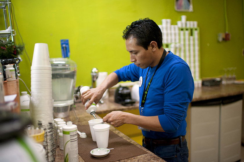 Herbalife nutrition club owner Edgar Montalban, shown in June 2013, prepares a meal-replacement shake in Queens, N.Y.