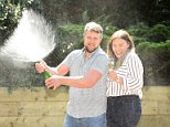Arron Walshaw, 32, left, and fiancee Ceri Hall, 23, right, are celebrating after he scooped £1million on a National Lottery raffle