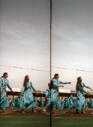 Girls dancing for the celebration of Saddam Hussein's birtthday, Tikrit, Iraq, 2002