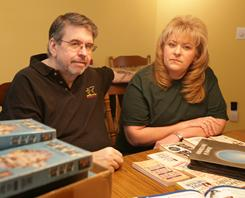 Jim and Lori Wittlich, here with some Amway marketing materials he bought.