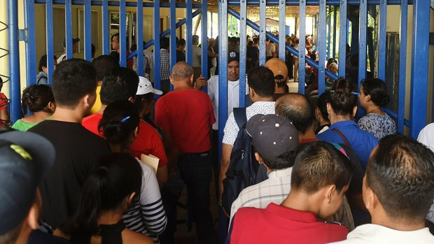 Nicaraguans queue at a migration office in Managua, to obtain their passports on June 13, 2018. - Thousands of Nicaraguans look frantically to obtain their passports to be able to migrate to Central American border countries, escaping from a two-month long uprising that's left at least 152 people dead. (Photo by MARVIN RECINOS / AFP)        (Photo credit should read MARVIN RECINOS/AFP/Getty Images)