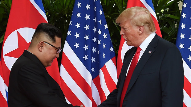 U.S. President Donald Trump and North Korea's leader Kim Jong Un shake hands during their summit at the Capella Hotel on Sentosa island in Singapore June 12, 2018. Anthony Wallace/Pool via Reuters