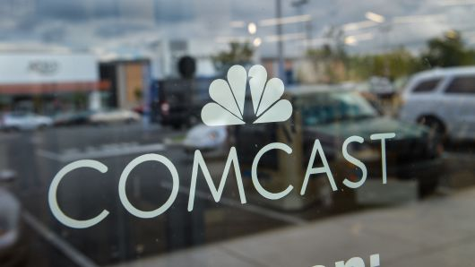 Signage is displayed in the window of a Comcast Corp. Xfinity store in King Of Prussia, Pennsylvania.