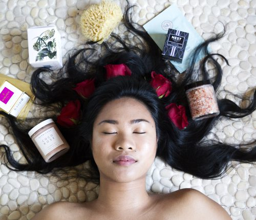 girl surrounded by bath products