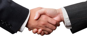 photo of two men handshaking