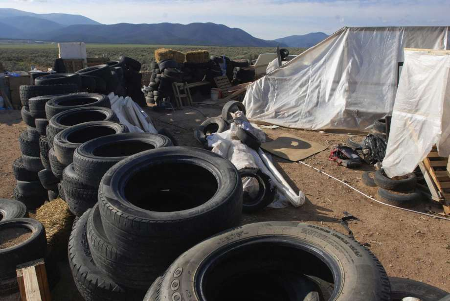 "FILE - In this Aug. 10, 2018, file photo, is a makeshift living compound in Amalia, N.M. Prosecutors seeking to keep two men and three women jailed on child-abuse charges in northern New Mexico now say they seized a document entitled ""Phases of a Terrorist Attack"" at the filthy desert compound where 11 children and a dead boy were found. In a court filing Friday, Aug. 24, 2018, prosecutors said the hand-written document had instructions for ""The one-time terrorist"" and mentioned an unnamed place called ""the ideal attack site."" Photo: Morgan Lee, AP / Copyright 2018 The Associated Press. All rights reserved."
