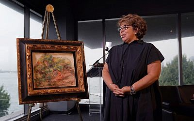 A Renoir painting, 'Deux Femmes Dans Un Jardin,' stolen by the Nazis was returned to the heir of its rightful owner, Sylvie Sulitzer, during a ceremony at the  Museum of Jewish Heritage in New York on September 12, 2018. (AFP/Timothy A. Clary)