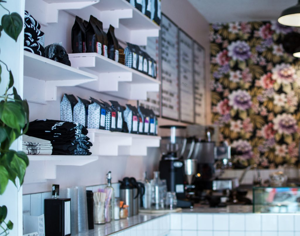 pink coffee shop with flower wall
