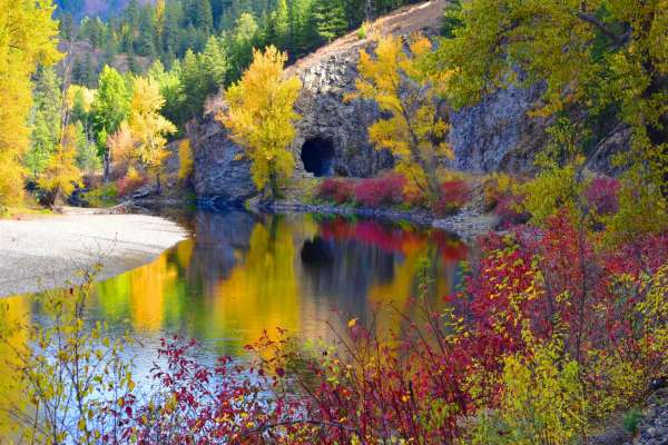 Fall colors are seen along the Kettle River trail in Eastern Washington's Ferry County. This section was closed due to washout, but was expected to reopen before the end of September.