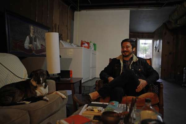 Aidan Nathanson, a 24-year-old IT project manager, lives in a refurbished garage in the Sunset District. He pays $350 a month in rent.