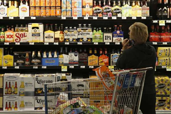 A customer looks over the beer selection at Crest Foods in Oklahoma City, Monday, Oct. 1, 2018. Beginning Monday grocery stores and convenience stores in Oklahoma can legally sell wine and strong beer.