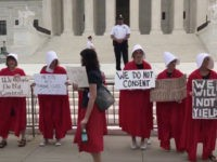 'Handmaids' Protest Brett Kavanaugh's First Day on Supreme Court