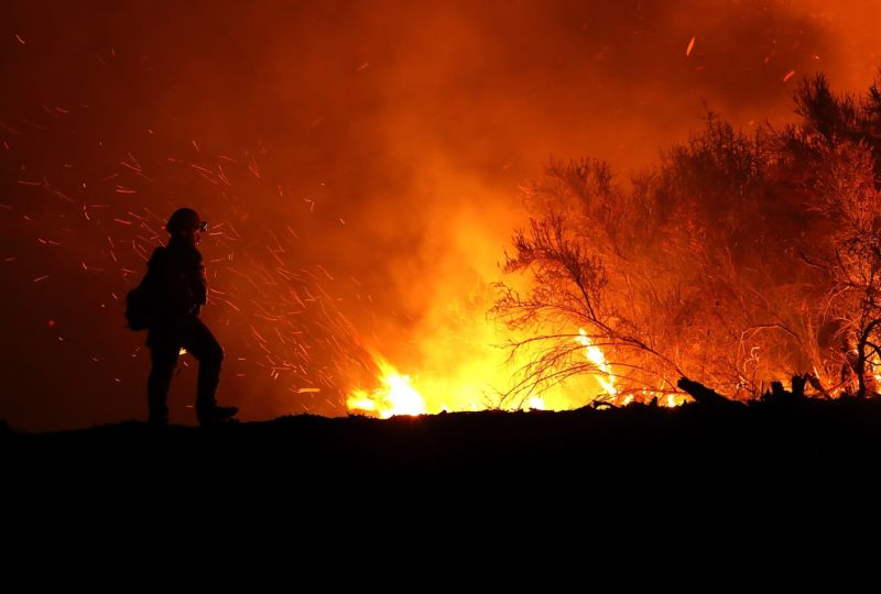 A firefighter at the scene of a wildfire.