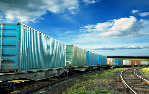 Train with shipping containers on train tracks