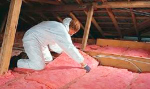 pink fiberglass insulation installation in attic