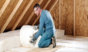 fiberglass insulation installation in attic