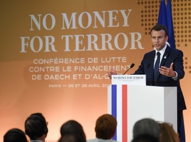 French President Emmanuel Macron gives a speech at an international conference to discuss ways of cutting funding to terrorist groups, at the OECD headquarters in Paris, France, April 26, 2018