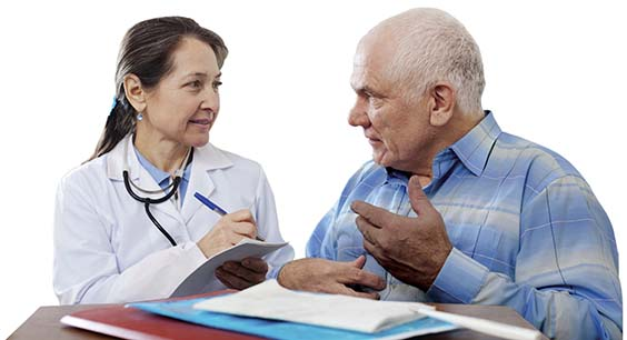 Older man asking a researcher questions about clinical trials
