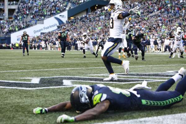 Seahawks wide receiver David Moore is facedown on the ground after missing an attempted touchdown pass in the final play of the Seahawks game against the LA Chargers, Sunday, Nov. 4, 2018 at CenturyLink Field.