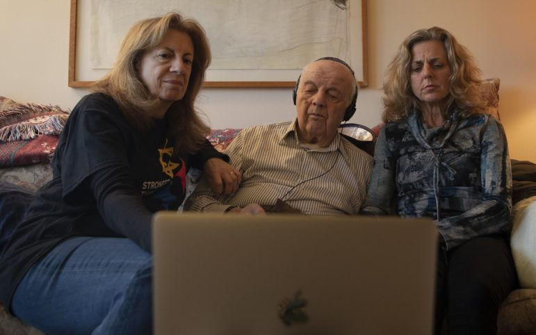 (From left to right) Avi Baran Munro, 61, her father, Moshe Baran, 97, and family friend, Adrienne Wehr, 57, sit in Moshe's living room to video-conference with younger family members about the shooting at the Tree of Life synangogue. (Photo by Kat Procyk/PublicSource)