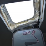 The crew escape hatch in the Boeing 787 Dreamliner's flight deck is a hatch located above the pilots. The cockpit windows cannot be opened. (STEVEN LUO/ CALIFORNIA BEAT PHOTO)