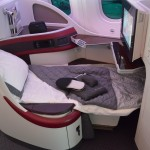 Qatar Airways 22 Business Class seats feature fully lie-flat beds and turndown service. (STEVEN LUO/ CALIFORNIA BEAT PHOTO)
