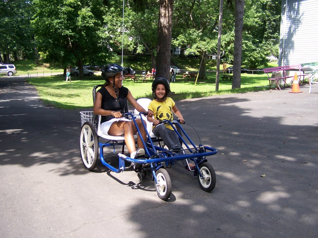 mom and daughter riding pedal cart