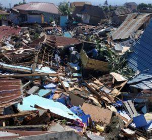 Mass burials as death toll in Indonesia quake-tsunami tops 800