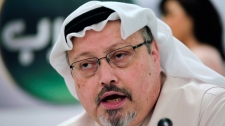 In this Feb. 1, 2015, file photo, Saudi journalist Jamal Khashoggi speaks during a press conference in Manama, Bahrain. The disappearance of Khashoggi, during a visit to his country's consulate in Istanbul on Oct. 2, 2018, raises a dark question for anyone who dares criticize governments or speak out against those in power: Will the world have their back? (AP Photo/Hasan Jamali, File)