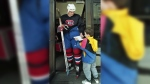 Montreal Canadiens' Todd Ewen signs an autograph for a fan at the Forum in Montreal, May 27, 1993. (THE CANADIAN PRESS/Ryan Remiorz)