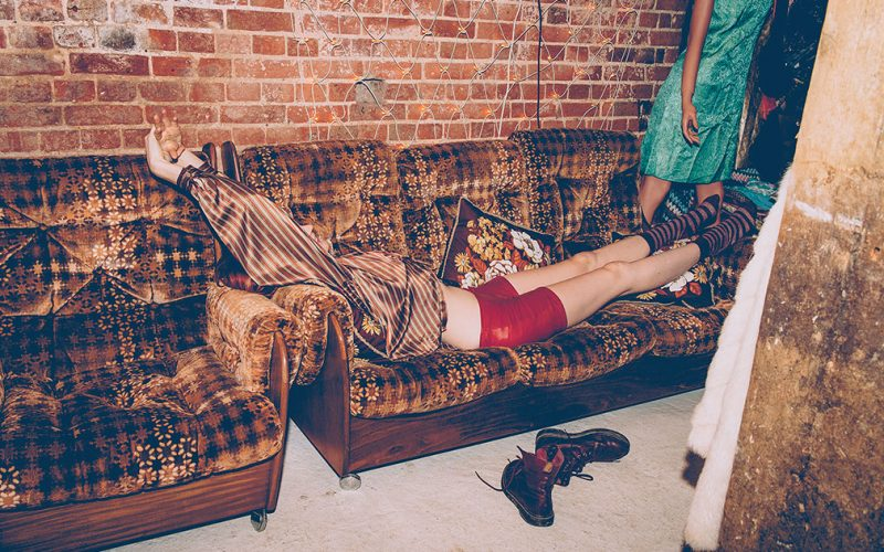 Image of vintage style girl lying on sofa by photographer Kerry Curl.
