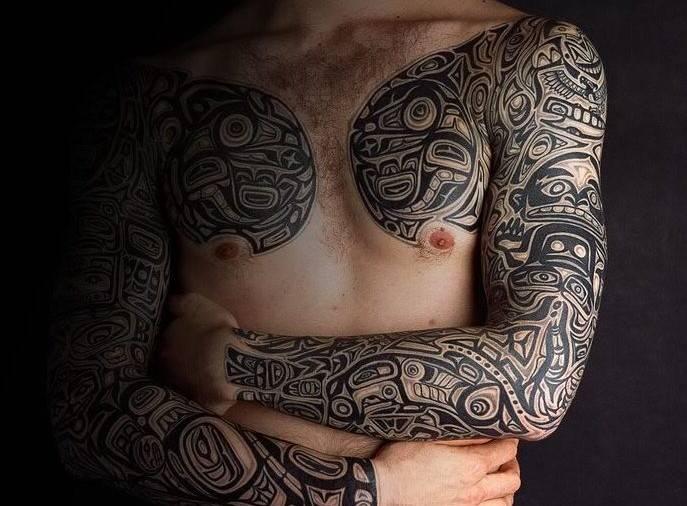 Tribal tattoo sleeves guy