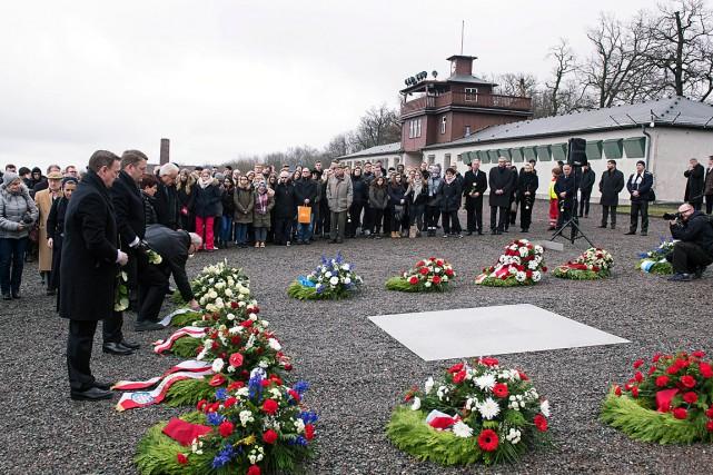 Une cérémonie marquant la journée de commémoration des... (PHOTO JENS MEYER, ASSOCIATED PRESS)