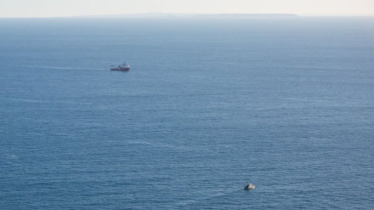 The AAIB boat in the background and the private search boat in the foreground