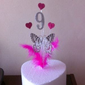 Beautiful cupcake cake topper with butterfly and hearts