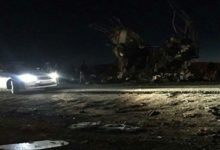 Cars at the scene of a roadside bomb attack on IRGC