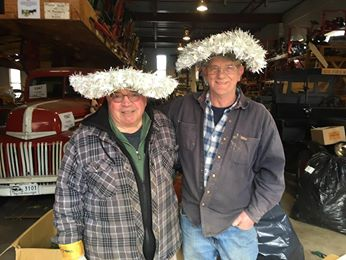 Image may contain: 2 people, people smiling, people standing, hat and indoor