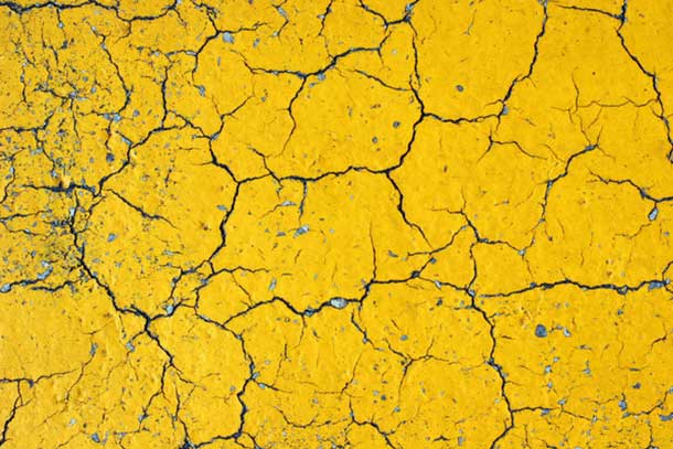 cracks-on-yellow-asphalt