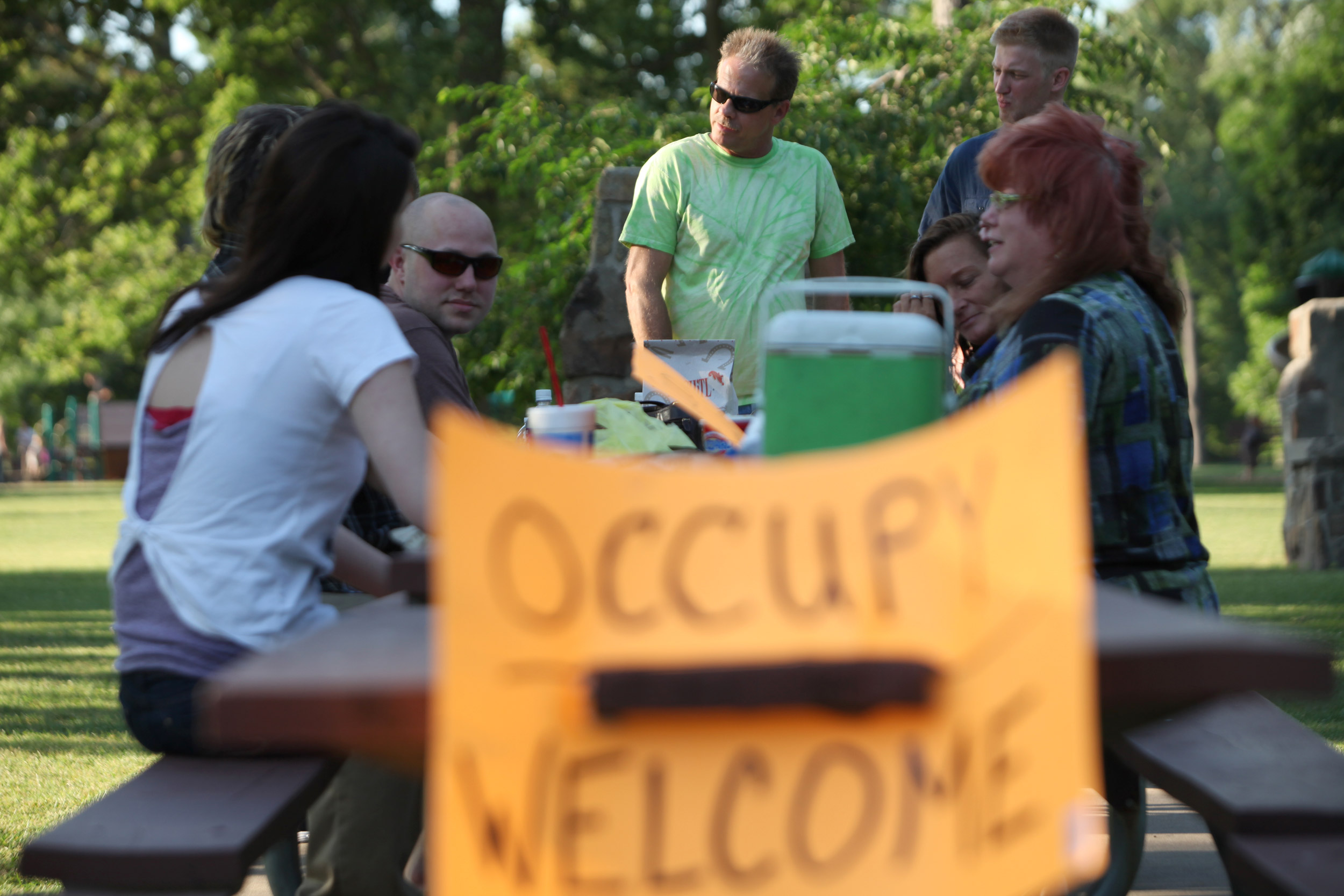 Scott Youngkin (in green) is new to protesting, but already one of the leaders of the Occupy 417 movement.