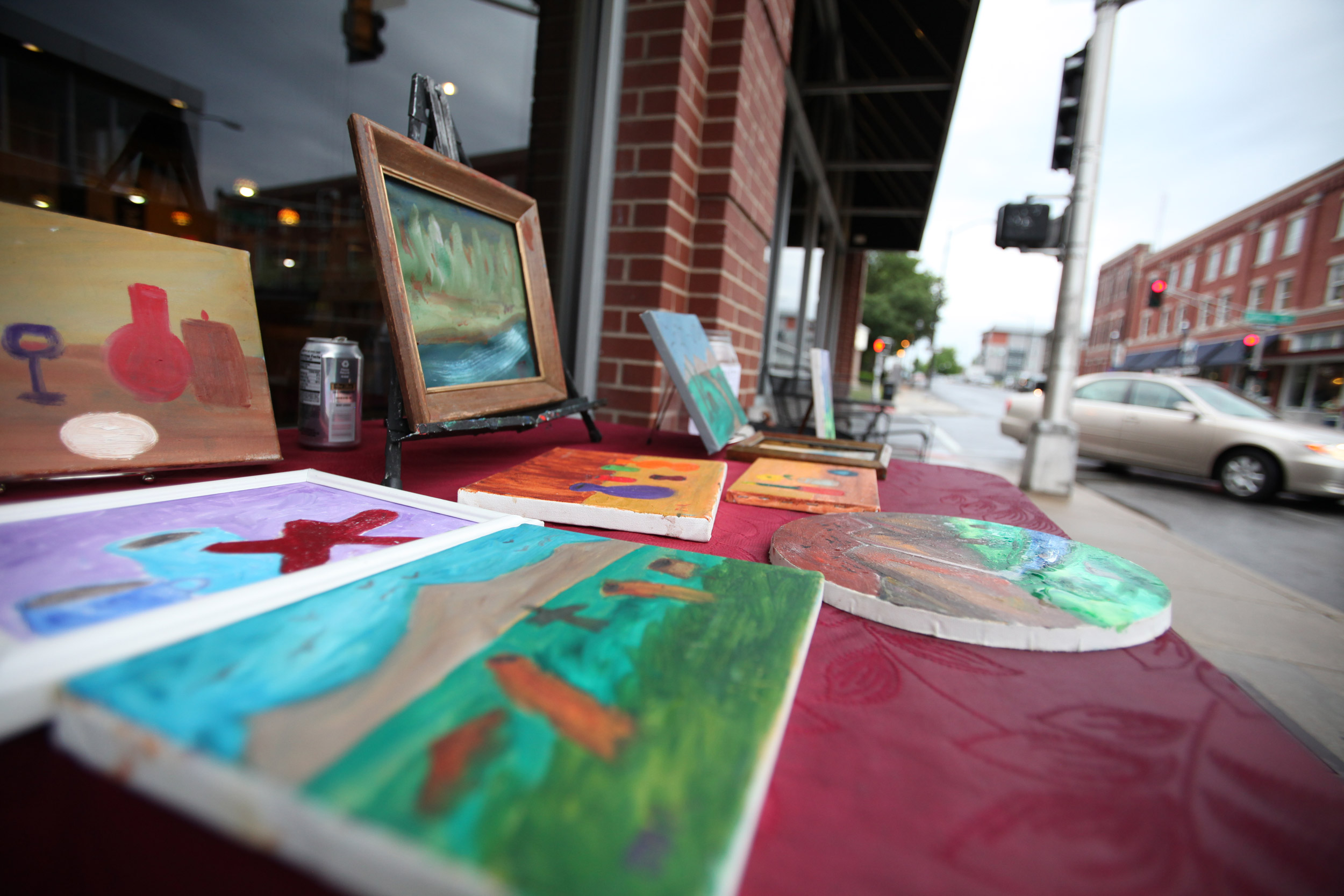 Russell's art, on display on Walnut Street in Springfield. Russell paints primarily oils on canvas.