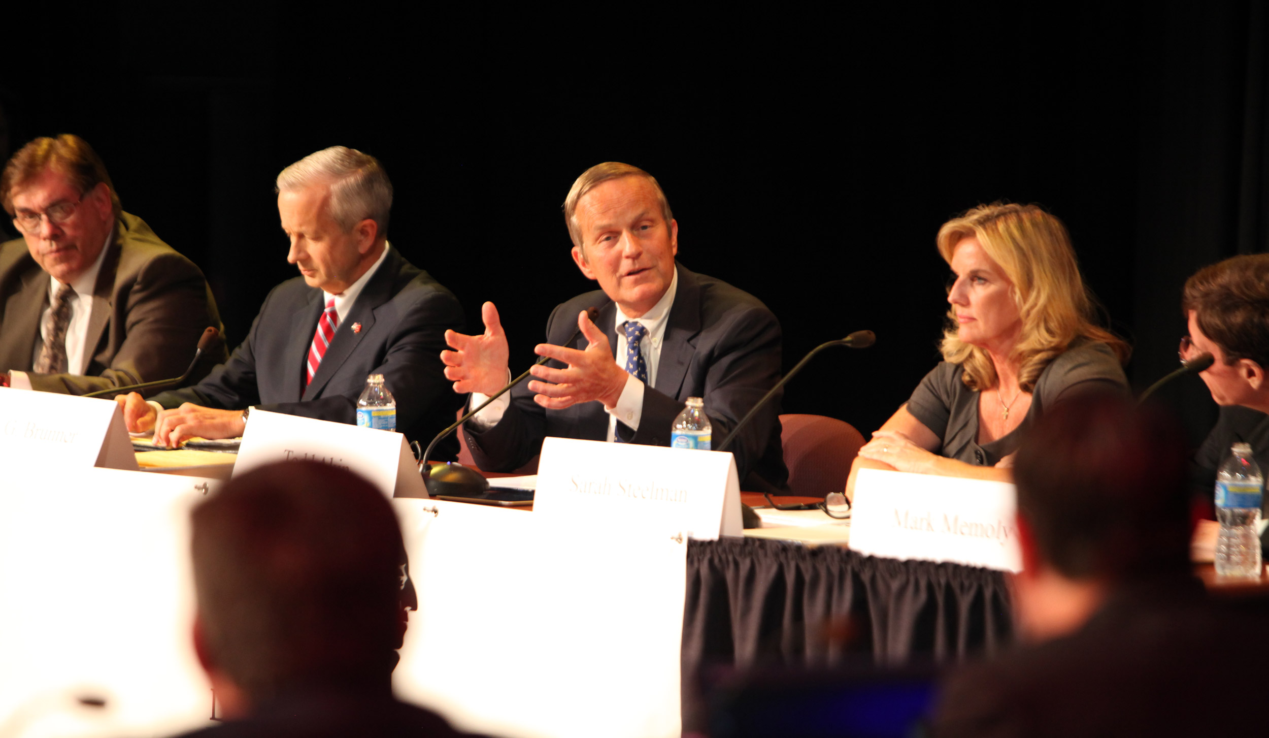 At the Willard, Mo., debate., Todd Akin gestures while answering. To his left, John Brunner. To his right, Sarah Steelman.