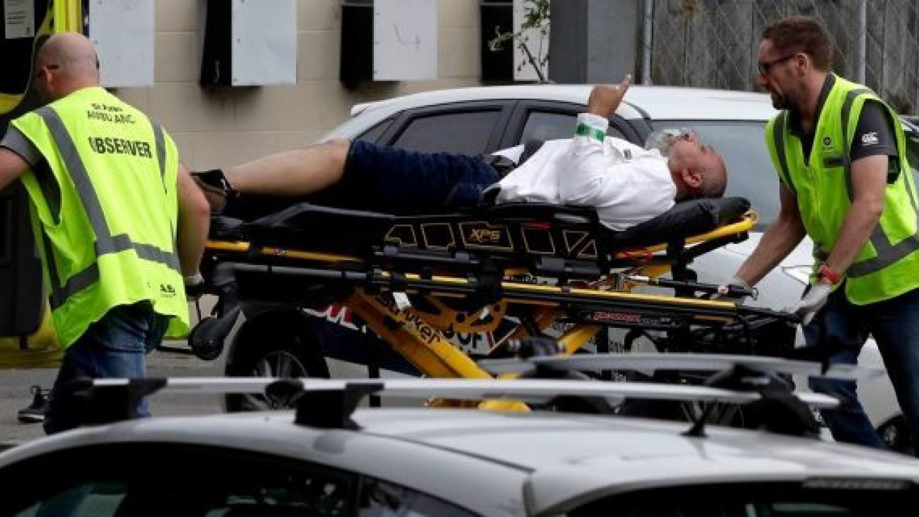 Ambulance staff take a man from outside a mosque in central Christchurch, New Zealand, Friday, March 15, 2019. A witness says many people have been killed in a mass shooting at a mosque in the New Zealand city of Christchurch.(AP Photo/Mark Baker)