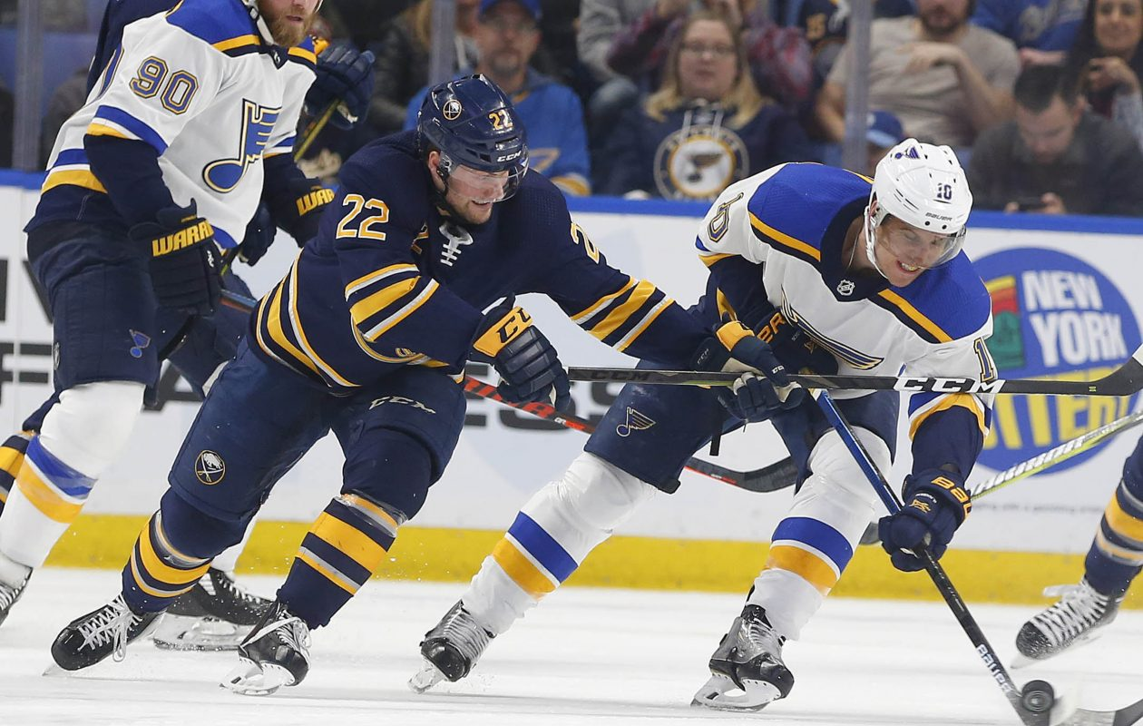 The Buffalo Sabres' Johan Larsson battles for the puck with the St. Louis Blues' Brayden Schenn in the first period at the KeyBank Center in Buffalo on Sunday, March 17, 2019. (Mark Mulville/Buffalo News)