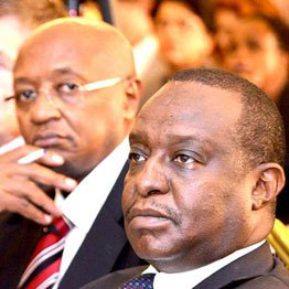Treasury Cabinet Secretary Henry Rotich and Treasury's director of