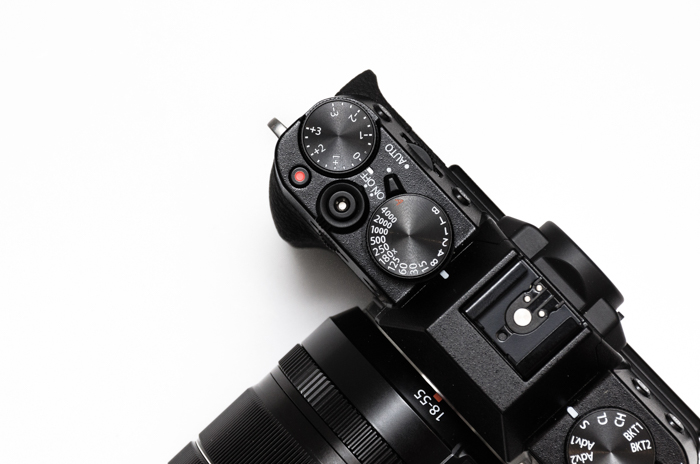 A overhead photo of a DSLR - exposure compensation settings